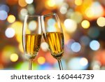 two glasses of champagne... | Shutterstock . vector #160444739