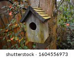 Wooden Bird House With...