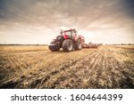 Photo Of Modern Red Tractor In...