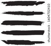collection of grunge brushes.... | Shutterstock .eps vector #1604702410