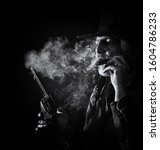 Western theme of a smoking cowboy with cigar and revolver in B&W. - stock photo