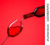 red wine is poured into a glass.... | Shutterstock . vector #1604869093