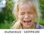 beautiful sad little girl... | Shutterstock . vector #160496180