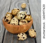Quail Eggs In A Wooden Bowl On...