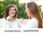 two young women talking happy... | Shutterstock . vector #160499390