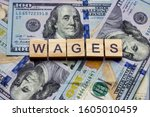 the word wages on dollar usa... | Shutterstock . vector #1605010459