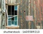Broken Window On An Abandoned...