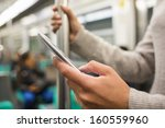 woman using her cell phone in... | Shutterstock . vector #160559960