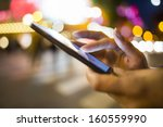 Woman Using Her Mobile Phone I...