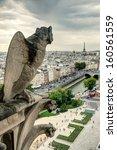 Gargoyle On The Notre Dame De...