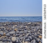 Dark Pebbles Beach  Blue Sea...