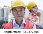 two engineers in protective... | Shutterstock . vector #160577408