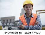 Portrait Of Proud Worker With...