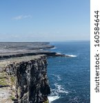 Small photo of Dun Aonghasa or Dun Aengus is the most famous of several prehistoric forts on the Aran Islands of County Galway, Ireland. It is on Inishmore, at the edge of an 100 metre high cliff