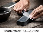sharpening the knife with...   Shutterstock . vector #160610720