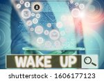 Small photo of Conceptual hand writing showing Wake Up. Business photo showcasing an instance of a demonstrating waking up or being woken up Rise up.