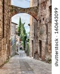 Todi, Umbria, Italy: picturesque ancient narrow alley with arch in the old town  - stock photo