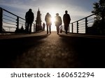 Silhouette Of People Walking...