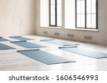 Unrolled yoga mats on wooden...
