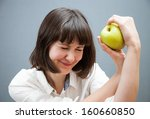 laughing girl holding a green... | Shutterstock . vector #160660850