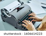 Close Up Of Woman Typing With...