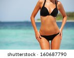 sexy woman body on the beach... | Shutterstock . vector #160687790
