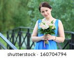 Beautiful Woman In Blue Dress...