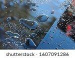 Wet Hood Of Black Car.  Drops...