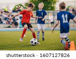 Young Boys Playing Soccer Game. ...