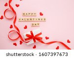 gift box with red ribbon and...   Shutterstock . vector #1607397673