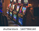 Row of Modern Casino Slot Machines with Shallow Depth of Field. Gambling Industry.  - stock photo