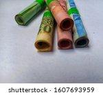 rolls of one hundred thousand... | Shutterstock . vector #1607693959
