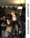 Small photo of Ashton Kutcher and Demi Moore at CHEAPER BY THE DOZEN World Premiere at the Chinese Theatre on December 13, 2003
