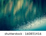 colorful reflection in water.... | Shutterstock . vector #160851416