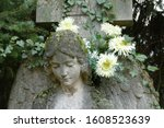 Angel Statue With White Flowers ...