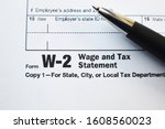 W 2 Tax Form With Pen Close Up
