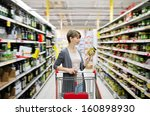 pretty woman with a cart... | Shutterstock . vector #160898930