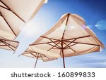 Sunshades In Front Of Blue Sky