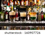 three layered shots on a bar... | Shutterstock . vector #160907726