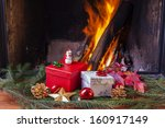 christmas presents at fireplace | Shutterstock . vector #160917149