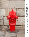 Red Fire Hydrant In Front Of A...