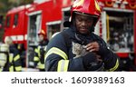 Portrait Of Heroic Fireman In...