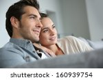 couple at home relaxing in sofa | Shutterstock . vector #160939754
