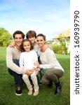 cute family portrait of 4 people | Shutterstock . vector #160939790