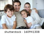 happy family of four relaxing... | Shutterstock . vector #160941308