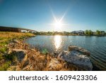 Lake With Rocky And Grassy...