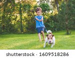 Small Boy And Dog Training To...
