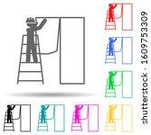 worker glues wallpaper multi...