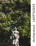 """Small photo of Statue """"La Grisette"""" against trees at Jules Ferry square in Paris, France"""