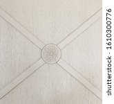 Small photo of Coat of arms on a white wooden background. texture